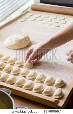 Cook Prepares Dumplings