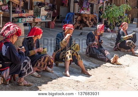 HA GIANG, VIET NAM, September 24, 2015 Dao ethnic group of women, the high mountains, Ha Giang. Sitting traditional brocade embroidery