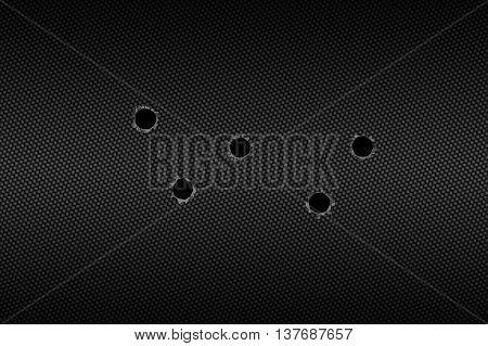 shotgun bullet hole on carbon fiber. metal background.