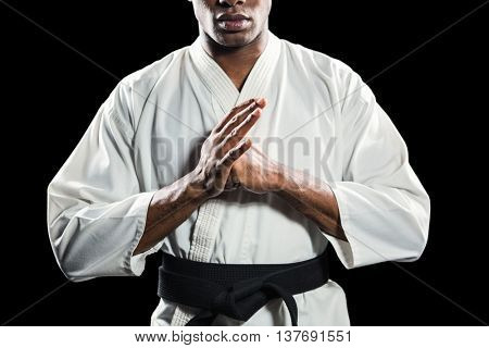 Fighter performing hand salute on black background