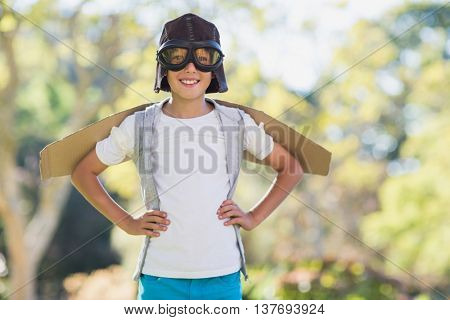 Boy pretending to be an aviation pilot in park