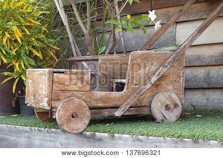 Car made of wood,childhood toy Drive. old stone age