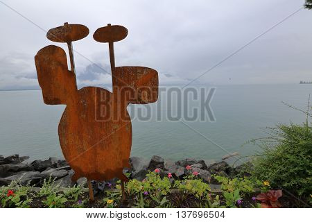 Art Object Against A Background Of Lake