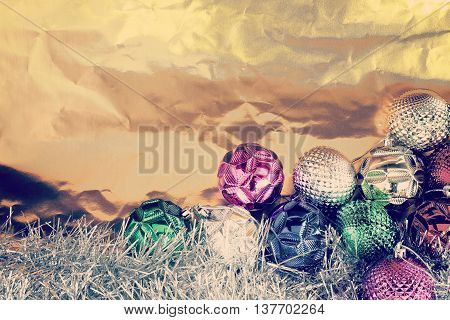 Christmas balls with shiny foil texture background retro style