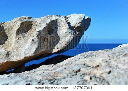 Rock formation and blue sea. Abstract rock formation.