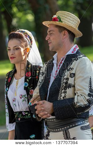 ROMANIA TIMISOARA - JULY 7 2016: Couple from Romania in traditional costume present at the international folk festival