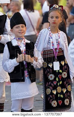 ROMANIA TIMISOARA - JULY 7 2016: Childrens from Romania in traditional costume present at the international folk festival