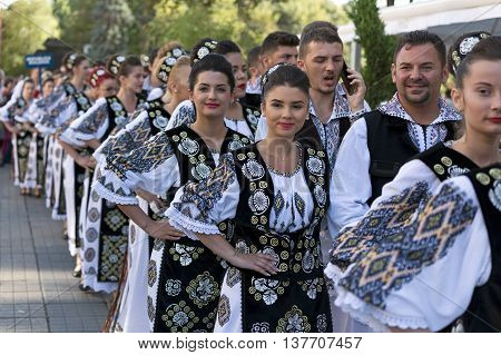 ROMANIA TIMISOARA - JULY 7 2016:Young people from Romania in traditional costume present at the international folk festival
