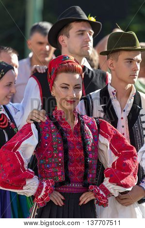 ROMANIA TIMISOARA - JULY 7 2016:Woman and man from Romania in traditional costume present at the international folk festival
