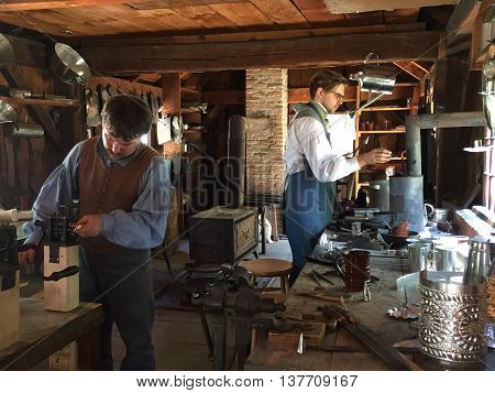 STURBRIDGE, MA - JUN 26: Tin shop at Old Sturbridge Village in Sturbridge, Massachusetts, as seen on Jun 26, 2016. It is a living museum which re-creates life in rural New England during the 1790s through 1830s.