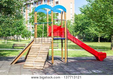 children slide in public park garden outdoor leisure safe care