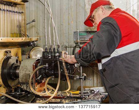 Professional Mechanics Testing Diesel Injector In His Workshop, Repair Of Diesel Fuel Injectors, Ust