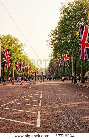 The Mall Road With Flags Leading To Buckingham Palace