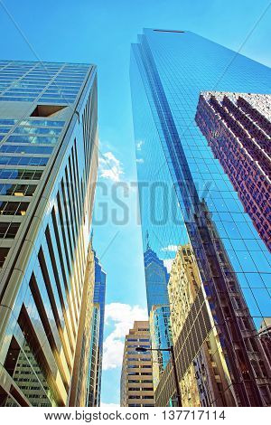 Bottom-up View To Skyscrapers Reflected In Glass In Philadelphia