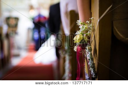 bridal bouquet of flowers at church. selective focus
