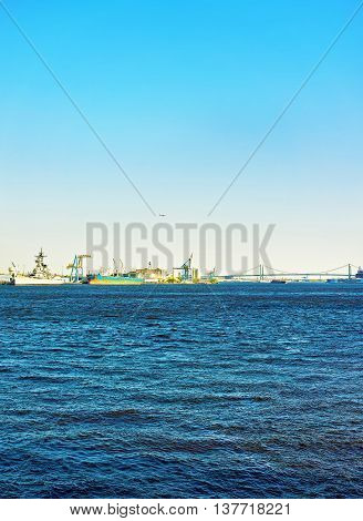 Ships near Benjamin Franklin bridge over Delaware River in Philadelphia Pennsylvania the USA.