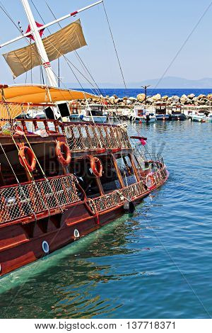 Traditional wooden Gulet cruise boat sinks whilst in harbor