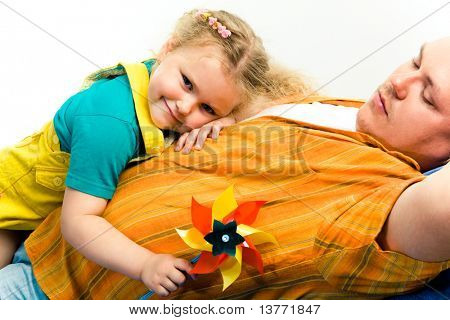 Image of tired man and small pretty girl having a rest after game