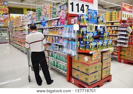 People Shop At Big C Hypermarket In Bangkok