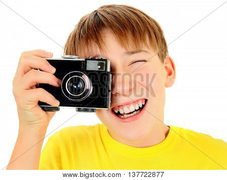 Cheerful Kid with Vintage Camera Isolated on the White Background
