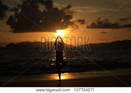 a man is dancing at the sunset on the evening