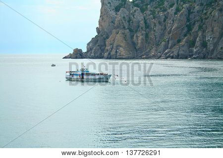 Unidentified people bathe on the yacht in the waters of the Black Sea near the Noviy Svet Ukraine.