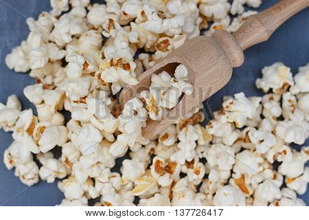 A lot of popcorn and a small wooden spatula