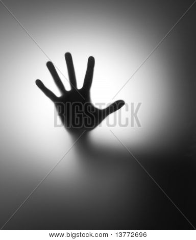 Hand Behind Matted Glass