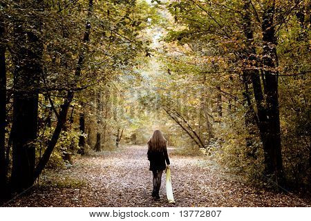 Sad Woman Walking Alone In The Woods