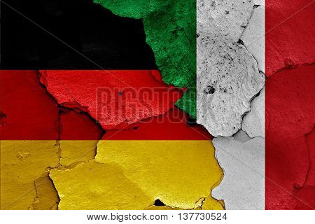 Flags Of Germany And Italy Painted On Cracked Wall