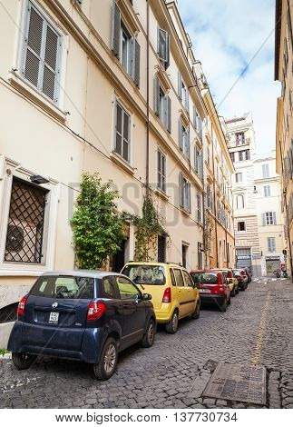 Ordinary Street In Old Rome With Cars