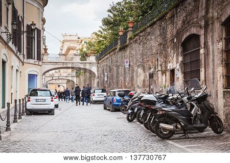 Street In Old Rome With Parked Cars And Motorcycles