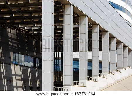 MINSK BELARUS - MAY 03 2016: Minsk-Arena - a sports and entertainment complex in the city of Minsk Belarus. Close-up of modern industrial architecture with a colonnade.