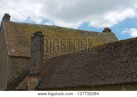 old house with clay roof in Bonneval, Eure et Loire, France