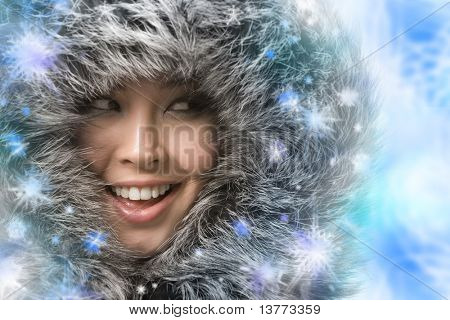 Creative photo of laughing woman framed by snowflakes