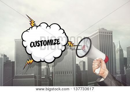 Customize text on speech bubble and businessman hand holding megaphone on cityscape background