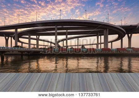 Opening wooden floor, Interchanged highway river front with beautiful sky background