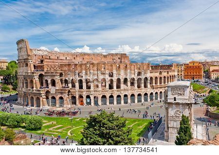 Colosseum in Rome Italy with tourists on sunny bright day. The Colosseum was built in the 70s AD and was the largest amphitheatre built during the Roman Empire. Major Italian landmark.