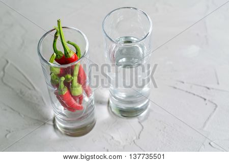 Shots with vodka and chilly peppers hot alcoholic drink