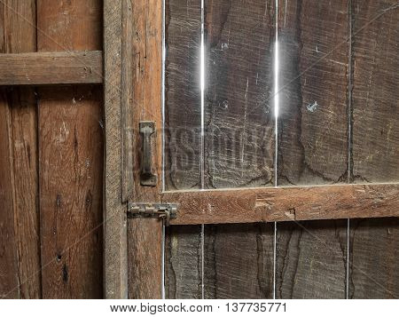 Closed old wooden door inside old garner