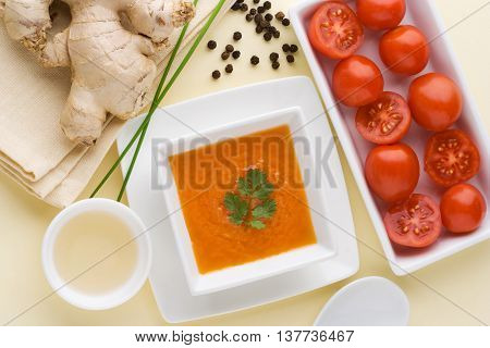 Top view of tomato vinaigrette with ingredients: ginger pepper vinegar tomato.