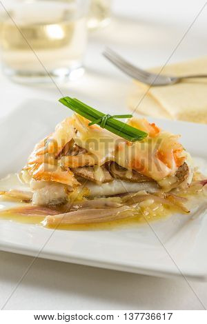 Sole fillet with mushrooms shrimps onions and cheese