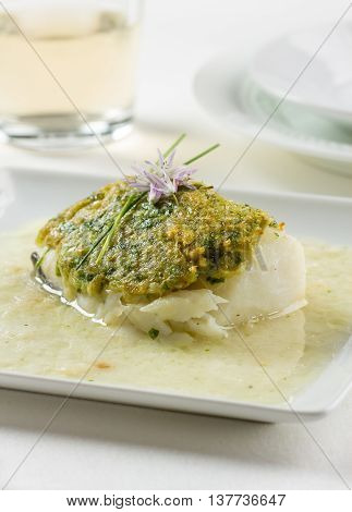 Bacalao fillet Basque style made with dried cod garlic green peppers onion and parsley.