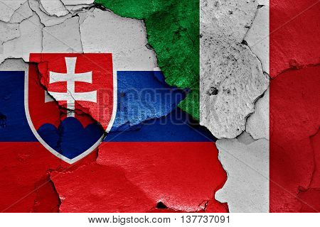 Flags Of Slovakia And Italy Painted On Cracked Wall