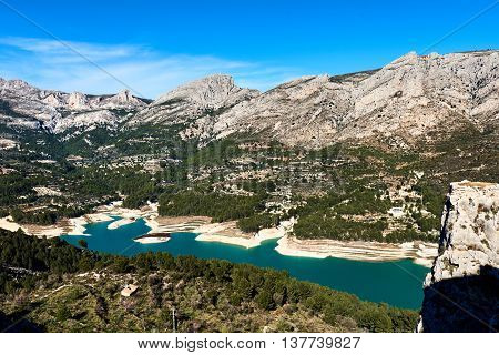 Guadalest Reservoir. Beautiful view of the valley with a dam and reservoir. Costa Blanca Province of Alicante. Spain