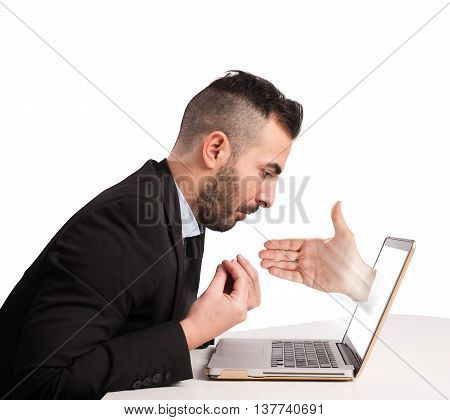 Man with hand coming out from computer