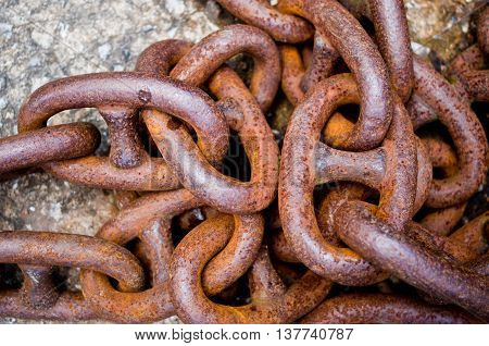 old rusty iron chains knotted and worn from use