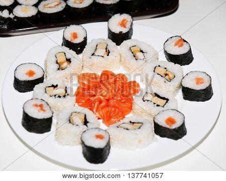 Homemade japanese sushi prepared wirh salmon and pork meat