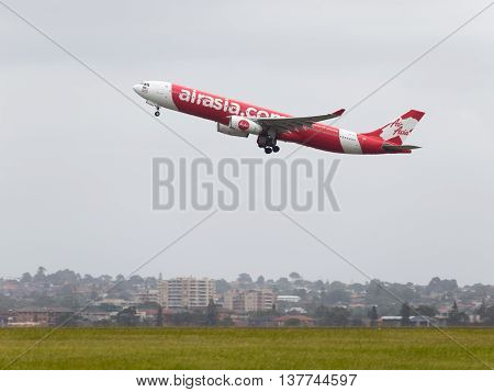 Sydney - February 26 2016: Big passenger Airbus A330-343 AirAsia takes off on the runway at the international airport in Sydney February 26 2016 Sydney Australia