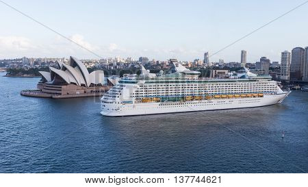Sydney - February 27 2016: Cruise ship Voyager of seas goes vport of Sydney and Sydney Opera House view from Harbour Bridge February 27 2015 Sydney Australia